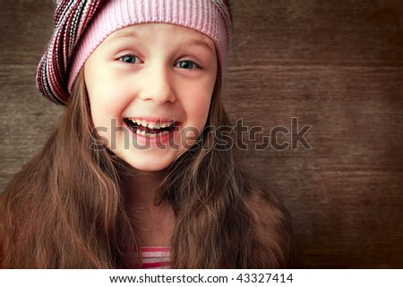 beautiful girl in hat and red dress smiling - stock photo
