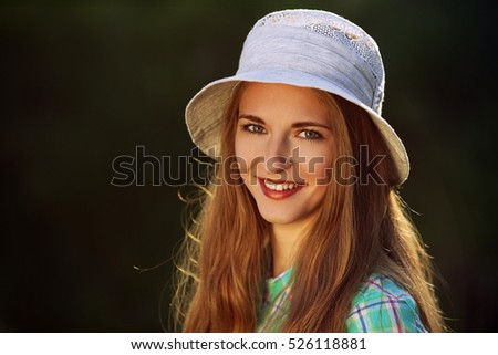Beautiful girl in hat smiles sincerely, live emotions close-up portrait