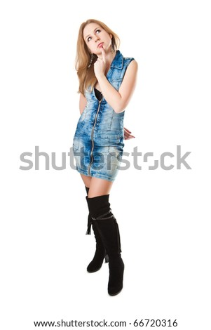 Beautiful girl in high boots isolated on a white background