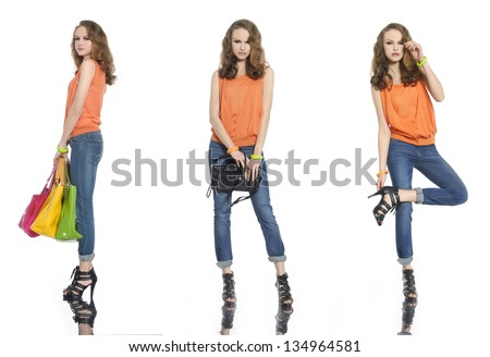 beautiful girl in jeans with colorful bag posing - stock photo