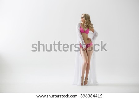 beautiful girl in lingerie and sexy robe - stock photo