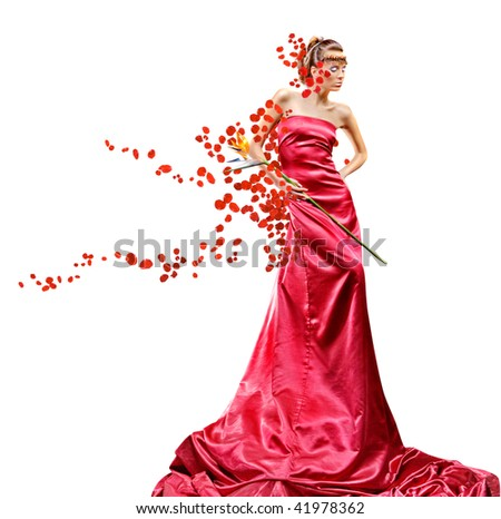 Beautiful girl in long red dress holds exotic flower in hand - stock photo