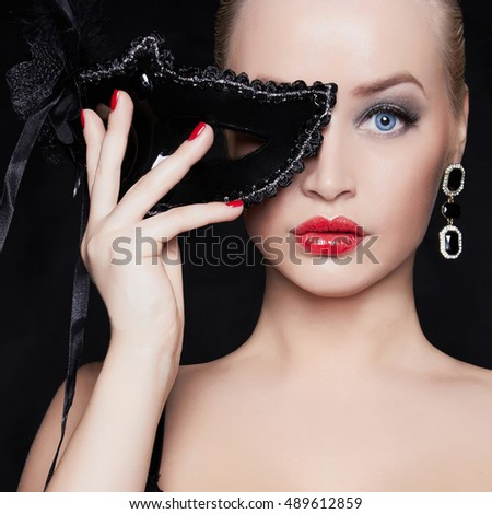 beautiful girl in mask.young blond woman.halloween