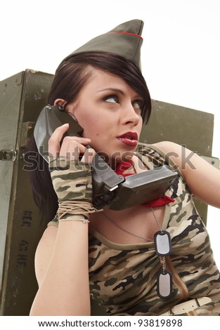 Beautiful girl in military clothes. studio shot - stock photo