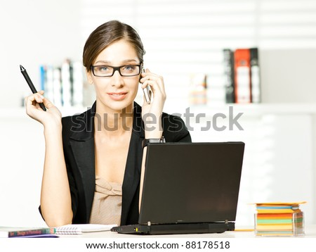beautiful girl in office with mobile