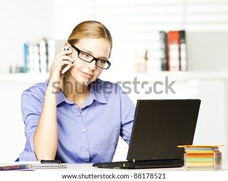 beautiful girl in office with mobile - stock photo