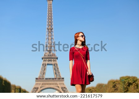 Beautiful girl in Paris with Eiffel tower on background. - stock photo