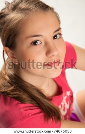 Beautiful Girl in pink Sitting looking up. - stock photo