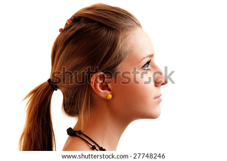 Beautiful girl in profile, it is isolated on white background. - stock photo