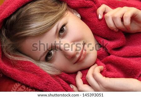 beautiful girl in red bathrobe - stock photo