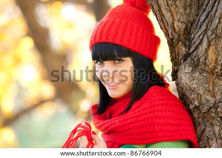 beautiful girl in red cap and scarf