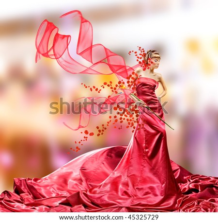 Beautiful girl in red dress - stock photo