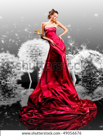 Beautiful girl in red dress against dandelions - stock photo