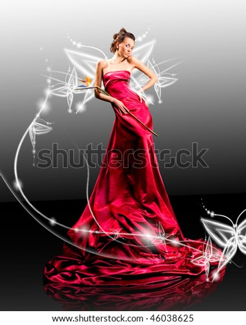 Beautiful girl in red dress against fantasy butterfly luminous - stock photo