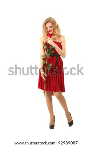 Beautiful girl in red dress standing with rose