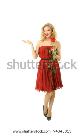 Beautiful girl in red dress standing with rose - stock photo
