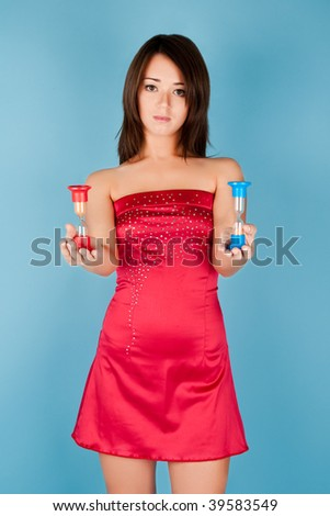 Beautiful girl in red dress with hourglass - stock photo