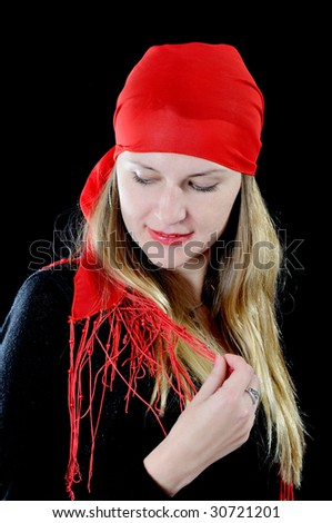 Beautiful girl in red kerchief, on black background - stock photo