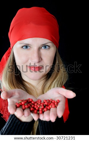 Beautiful girl in red kerchief with bead in hands, on black background - stock photo