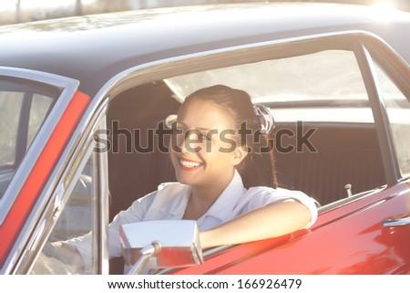 beautiful girl in retro car - stock photo