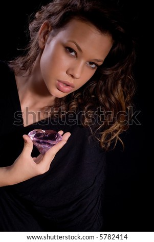 beautiful girl in 20s holding a diamond, vertical portrait