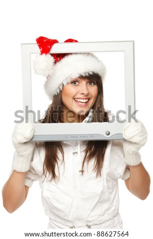 Beautiful girl in Santa hat broadcasting Christmas news from TV / computer screen, isolated on white background. Christmas news. - stock photo