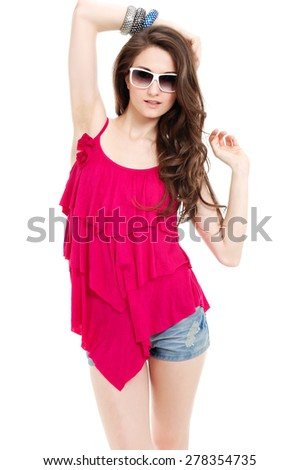 Beautiful girl in short blue jeans posing - stock photo