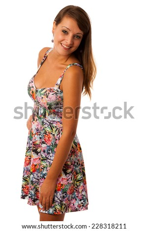 beautiful girl in short flower pattern summer dress posing against white background isolated