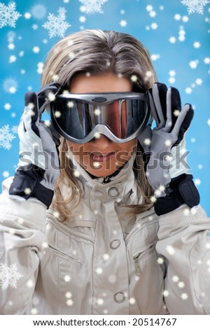 beautiful girl in ski clothes and snowflakes falling - stock photo
