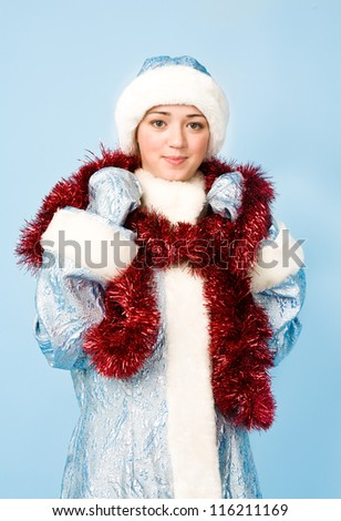 Beautiful girl in Snow Maiden costume with red tinsel - stock photo