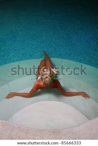 Beautiful girl in spa center - stock photo