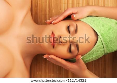 Beautiful girl in spa salon - stock photo