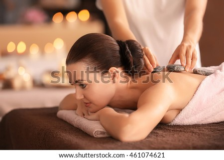 Beautiful girl in spa salon