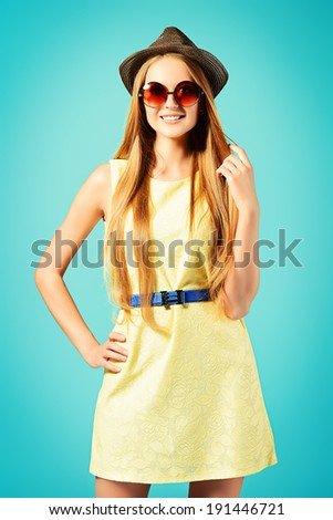 Beautiful girl in summer clothes and sunglasses. - stock photo