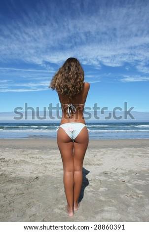 beautiful girl in the beach looking the sea - stock photo
