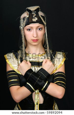 beautiful girl in the Egyptian costume on a black background - stock photo