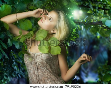 Beautiful girl  in the fairy forest - stock photo