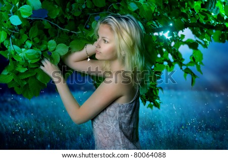 Beautiful girl in the fairy forest.Magic Night - stock photo