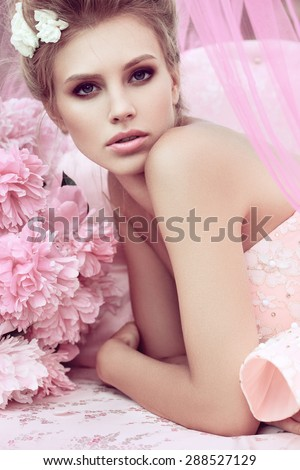 Beautiful girl in the flower garden. Princess. - stock photo