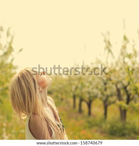 beautiful girl in the garden - stock photo