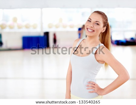Beautiful girl in the gym - stock photo