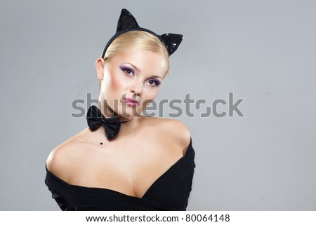 Beautiful girl in the image of a cat, studio portrait - stock photo