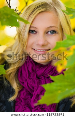 Beautiful girl in the middle of leaves, autumn colors - stock photo