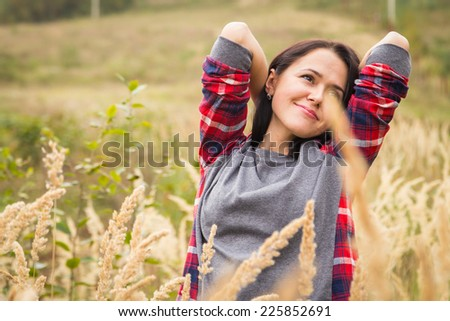 Beautiful girl in the mountains. Girl in high grass. Travel, tourism, trekking in the mountains - The concept of active rest. - stock photo