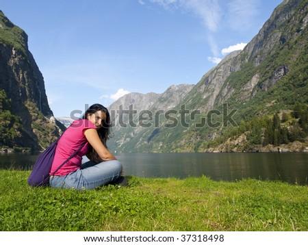 Beautiful girl in the Naeroyfjord in Gudvangen village - stock photo
