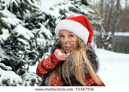 beautiful girl in the new year near Christmas tree with snow - stock photo