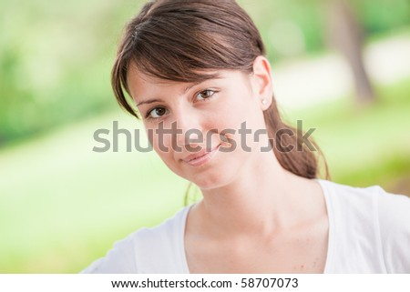 Beautiful girl in the park - stock photo