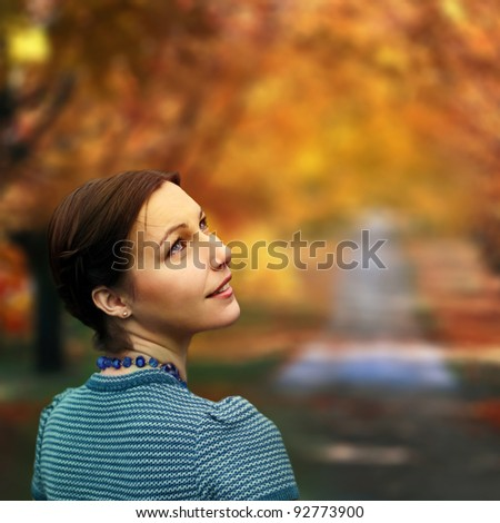 beautiful girl in the park in autumn - stock photo