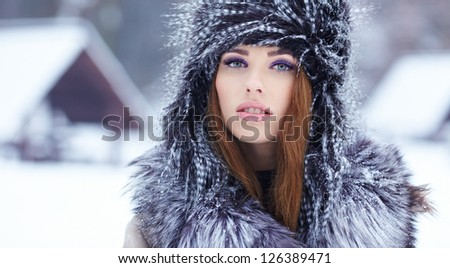 beautiful girl in the park in winter - stock photo