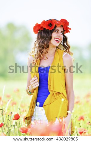beautiful girl in the poppy field